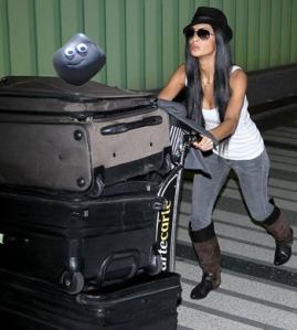 nicole-scherzinger-luggage-lax-12092010-lead
